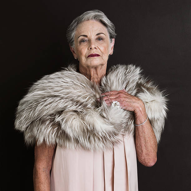 dressed to the nines and nowhere to be - mature women studio grey hair bildbanksfoton och bilder