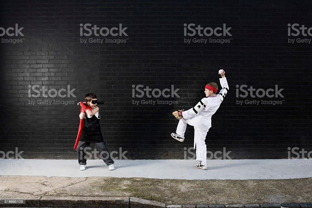 Dressed Up Boys Playing Baseball stock photo