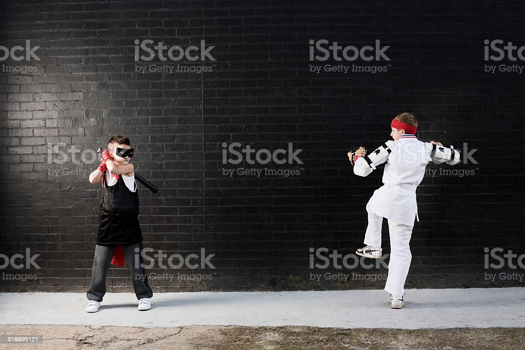 Dressed Up Boys Pretending To Fight stock photo