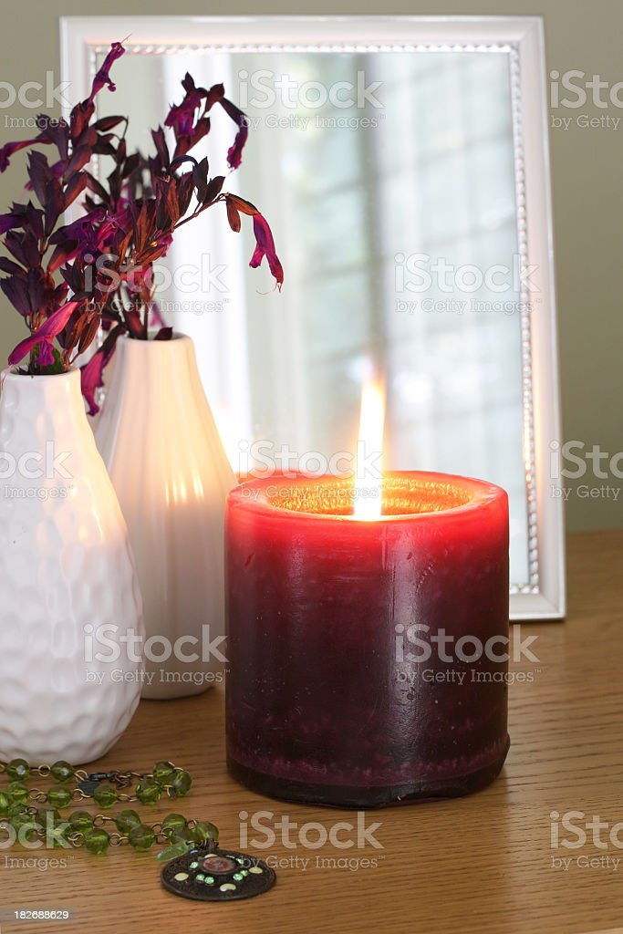 Dresser decoration with purple candle an ceramic vases royalty-free stock photo