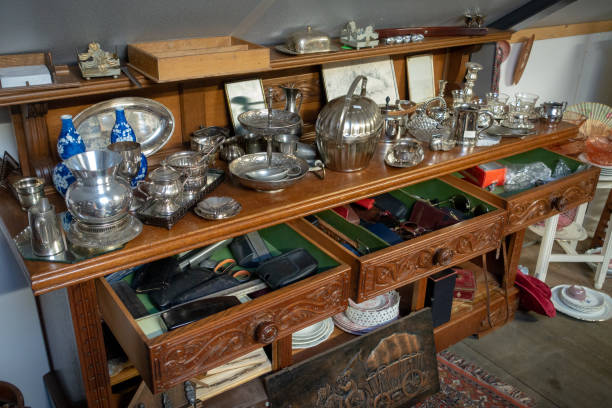 dresser with silver like bowls and cups stock photo
