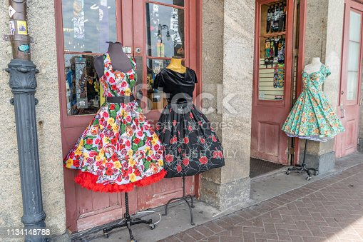 New Orleans, Louisiana / USA - February 14, 2019: Beautiful, retro dresses for sale at a cute shop in the famous French Quarter. New Orleans is known for great shopping opportunities.