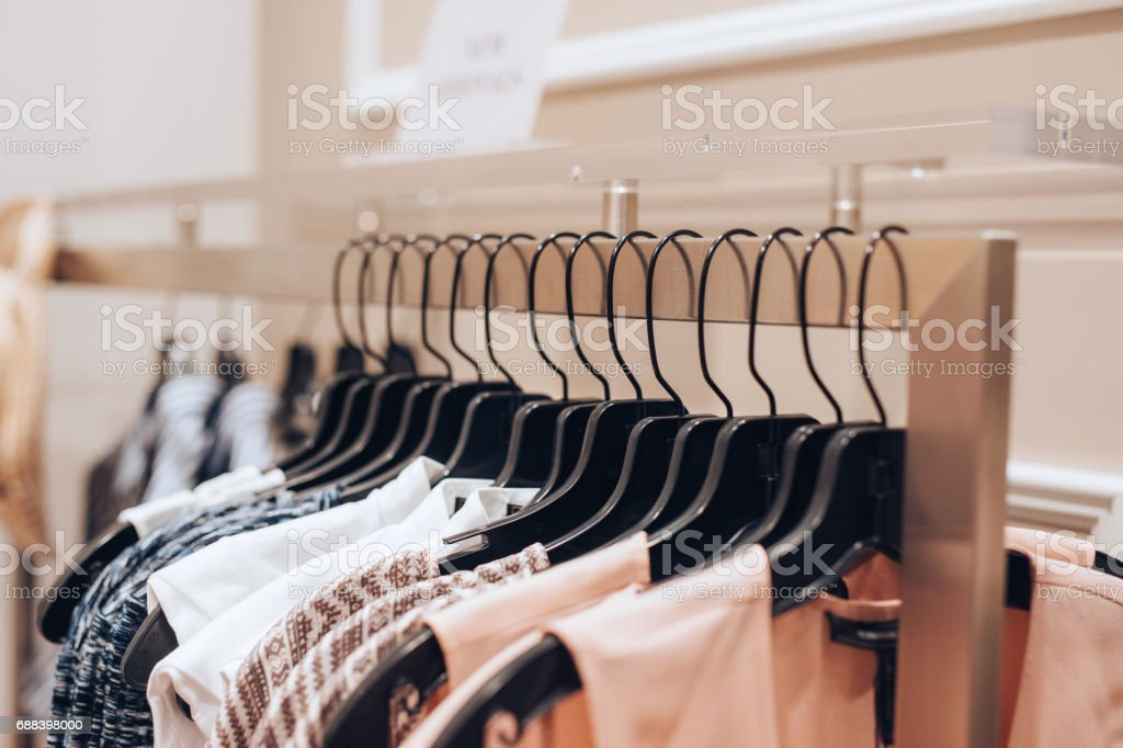 Dresses hanged in a clothing store stock photo