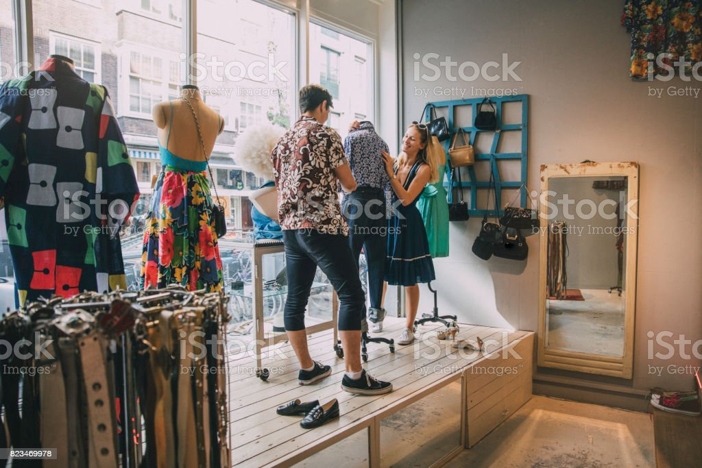 Dressing a Mannequin in a Shop Window stock photo