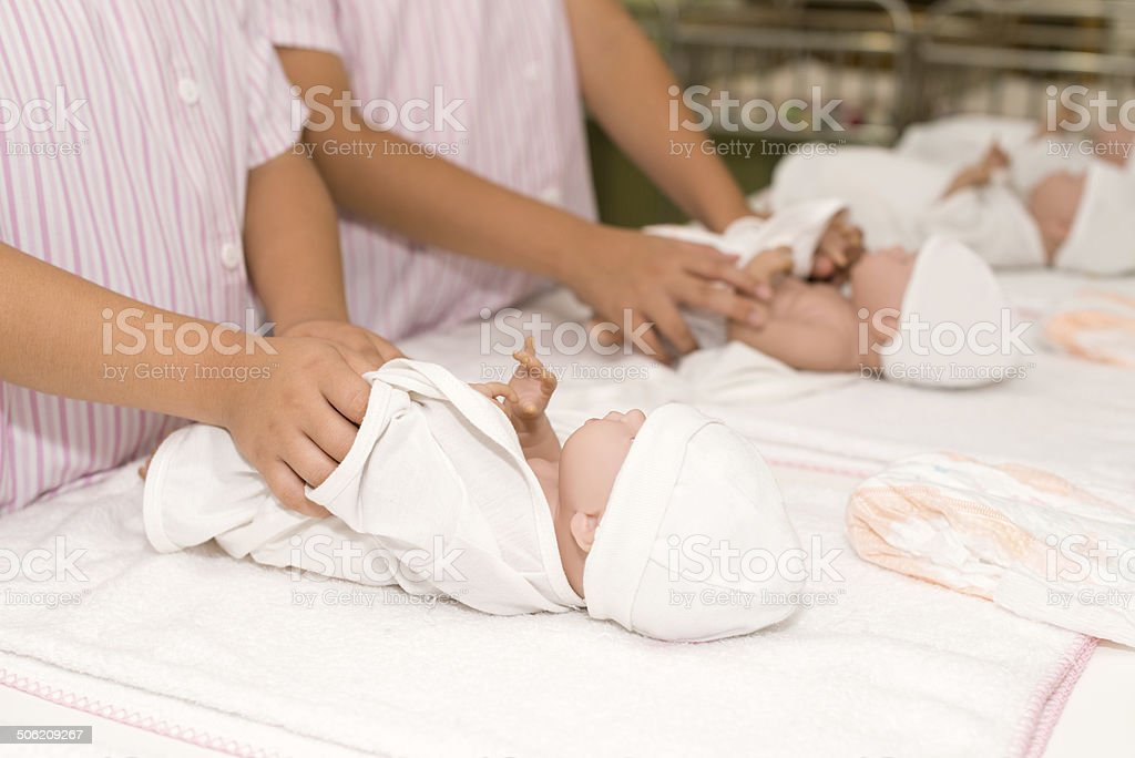 Dressing baby dolls stock photo