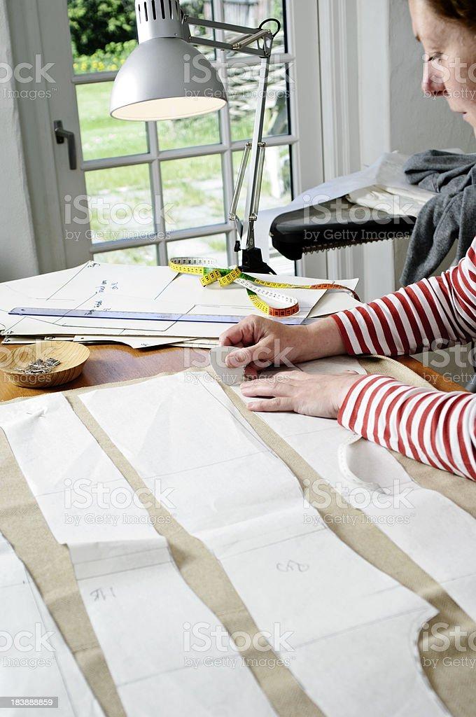 Dressmaker At Work In Her Design Studio royalty-free stock photo