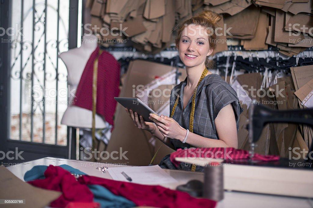 Dressmaker in her workshop royalty-free stock photo