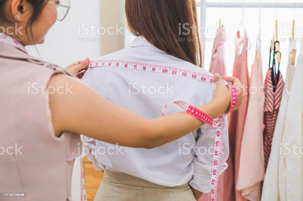 Dressmaker Measuring Female Customer Shoulder In Sewing Atelier Workshop Office Tailor And Fashion Designer Concept Job And Freelance Occupation Business People In Clothing Shop Stock Photo Download Image Now Istock