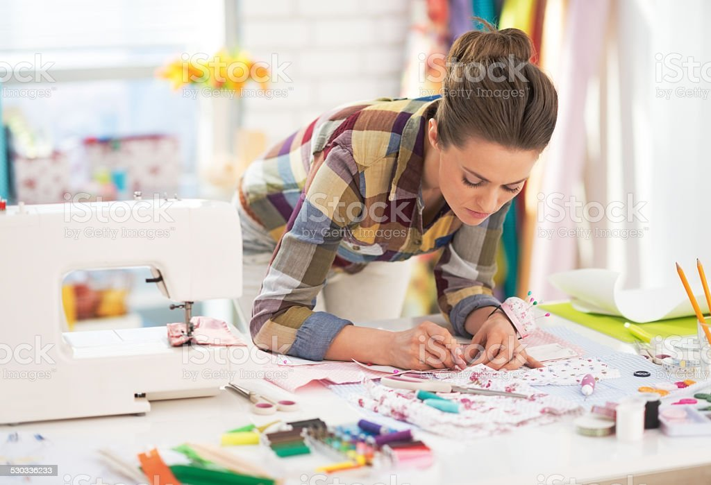dressmaker woman at work in studio stock photo