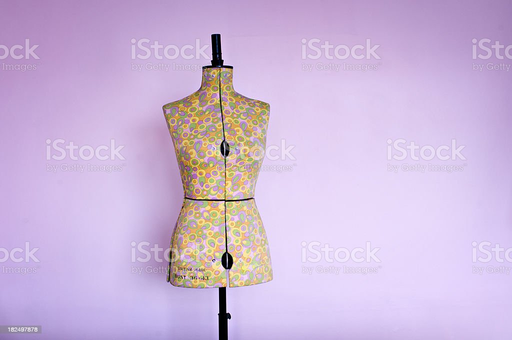 Dressmakers Dummy or Mannequin Against a Pink Background royalty-free stock photo