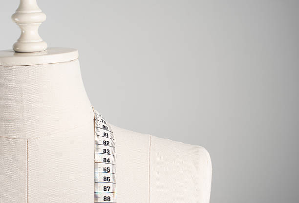 Dressmaker's Mannequin Dressmaker's mannequin with tape measure. retail equipment stock pictures, royalty-free photos & images