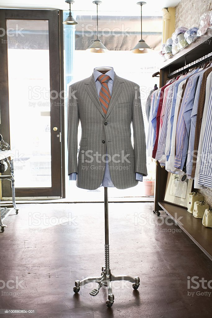 Dressmaker's model with grey jacket in store foto de stock libre de derechos