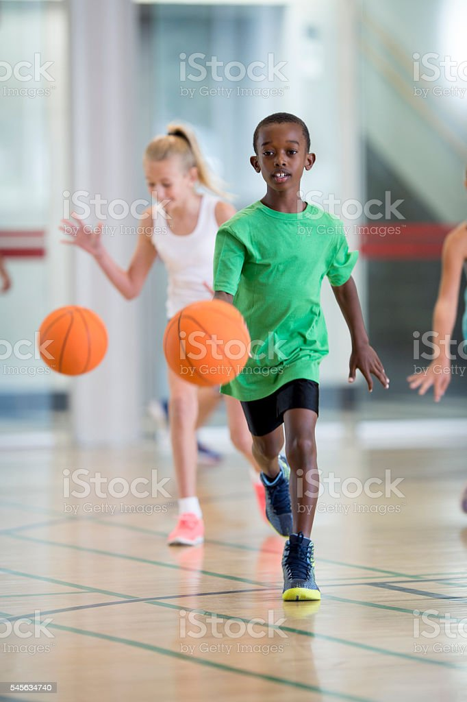 Dribbling a Ball During Recess stock photo