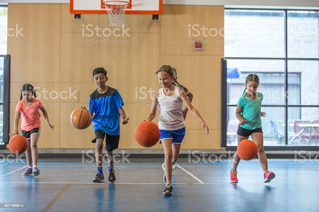 Dribbling Basketballs Up the Court stock photo