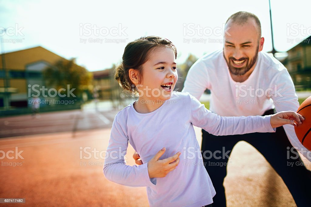 Dribbling with my dad stock photo