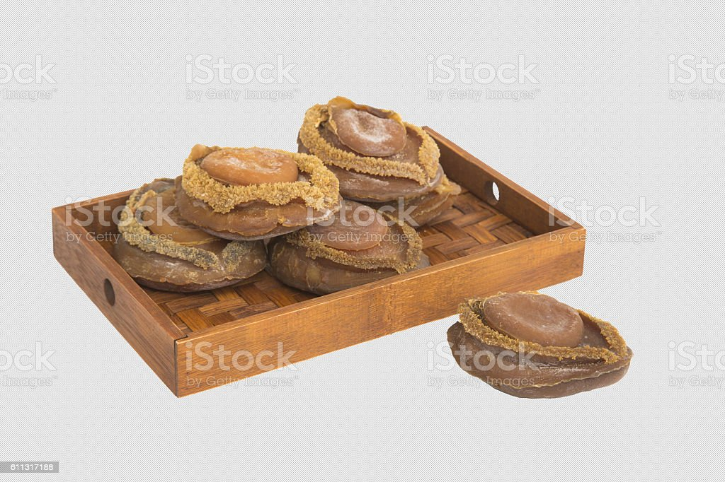 Dried abalone on bamboo tray in white background stock photo