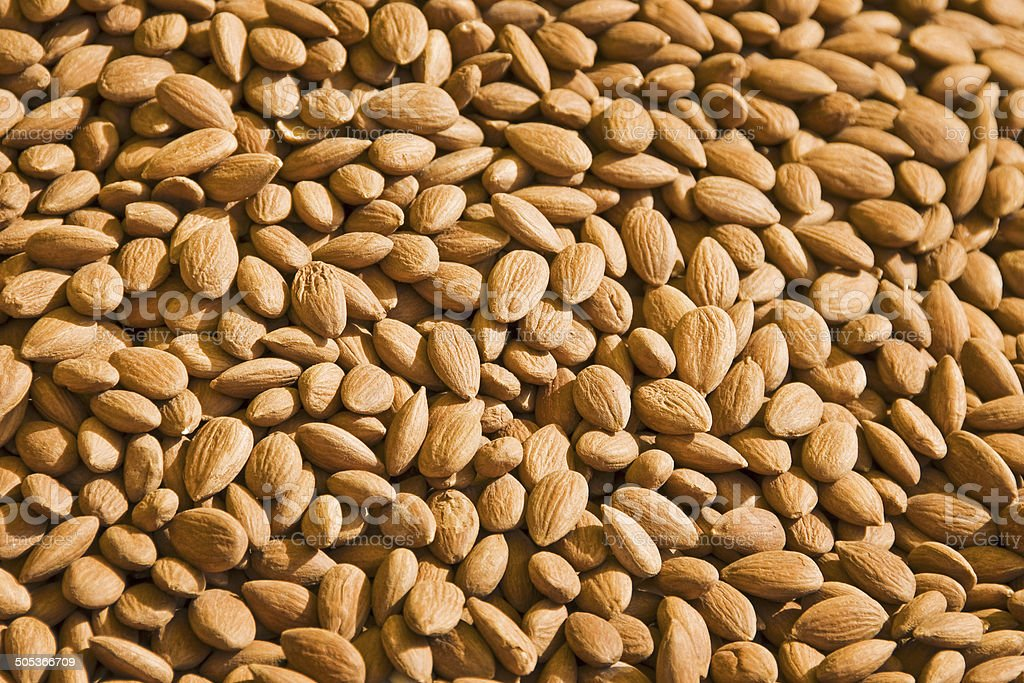 Dried almonds background stock photo
