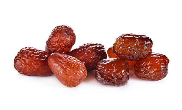 dried and sweetened Jujube fruite on white background dried and sweetened Jujube fruite on white background jujube candy stock pictures, royalty-free photos & images