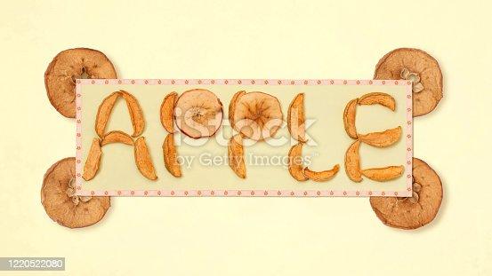 istock Dried apple lobules and inscription apple 1220522080