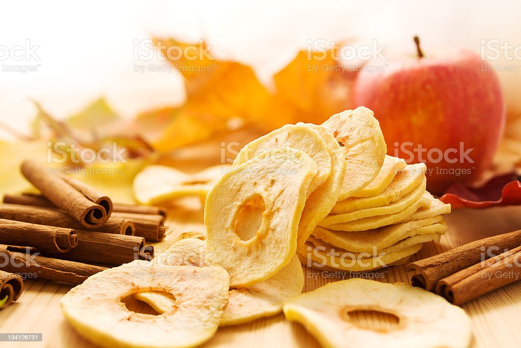 Dried apples and cinnamon stock photo