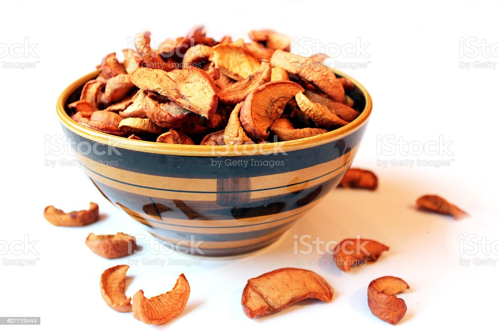 dried apples in the plate on the white background stock photo