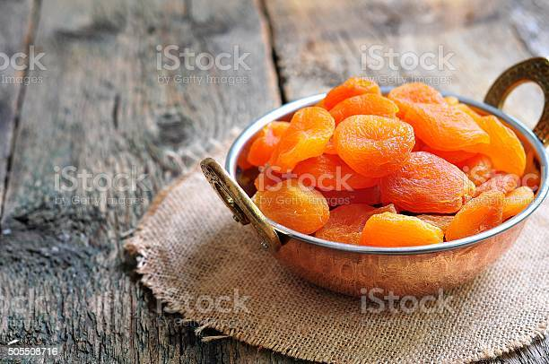 Dried Apricot In A Copper Bowl Stock Photo - Download Image Now
