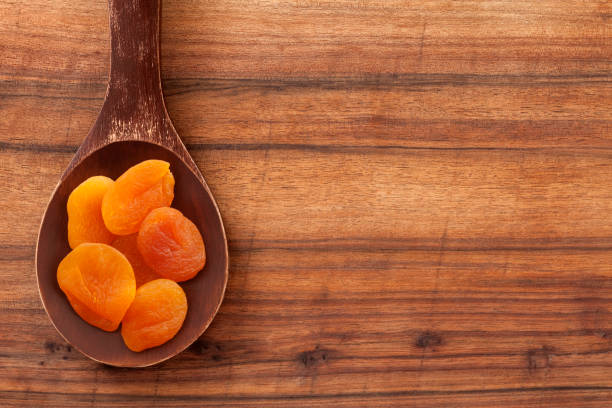 dried apricot - dried food stock photos and pictures