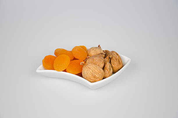 Dried Apricots And Figs Dried Apricots And Figs anhydrous stock pictures, royalty-free photos & images