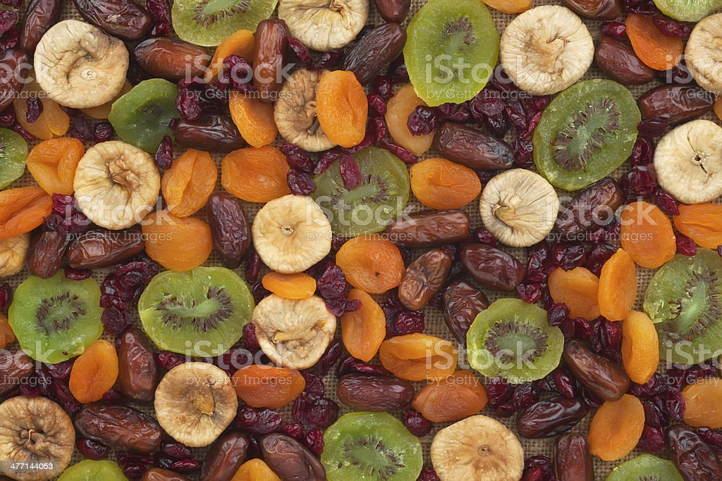Dried apricots, kiwi, figs, dates, cranberries on sackcloth royalty-free stock photo