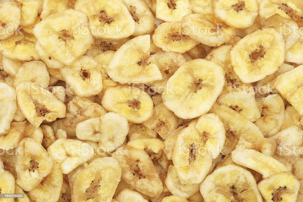 Dried banana chips as background stock photo