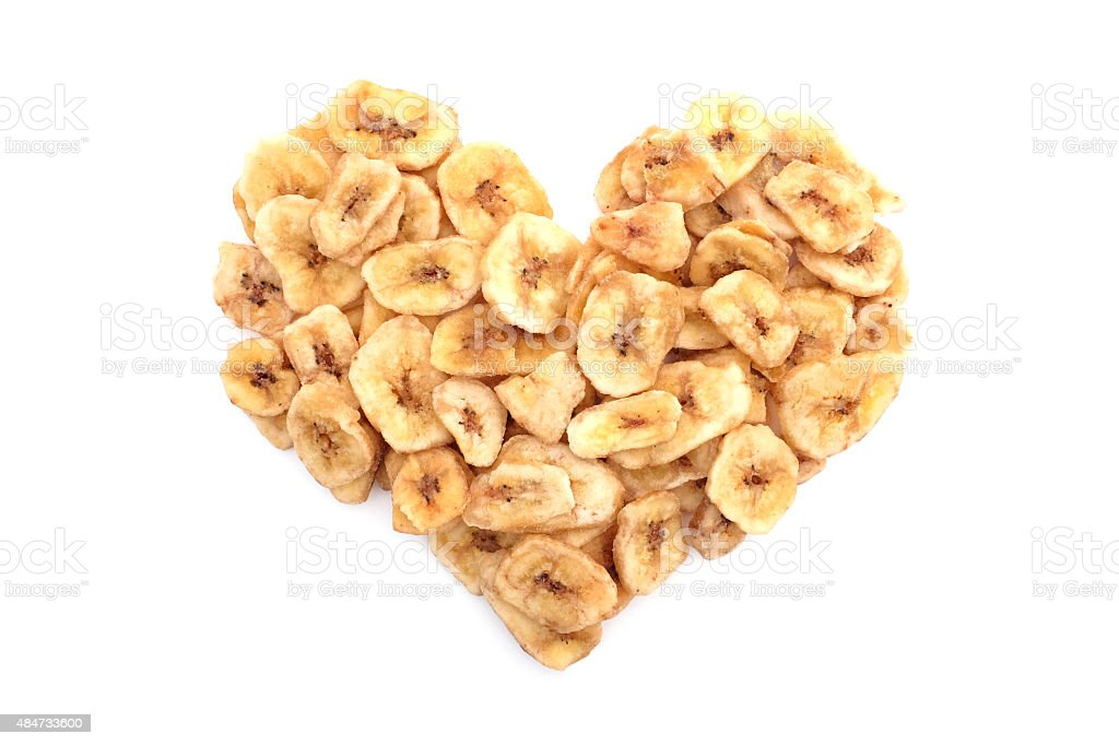Dried banana chips in a heart shape stock photo