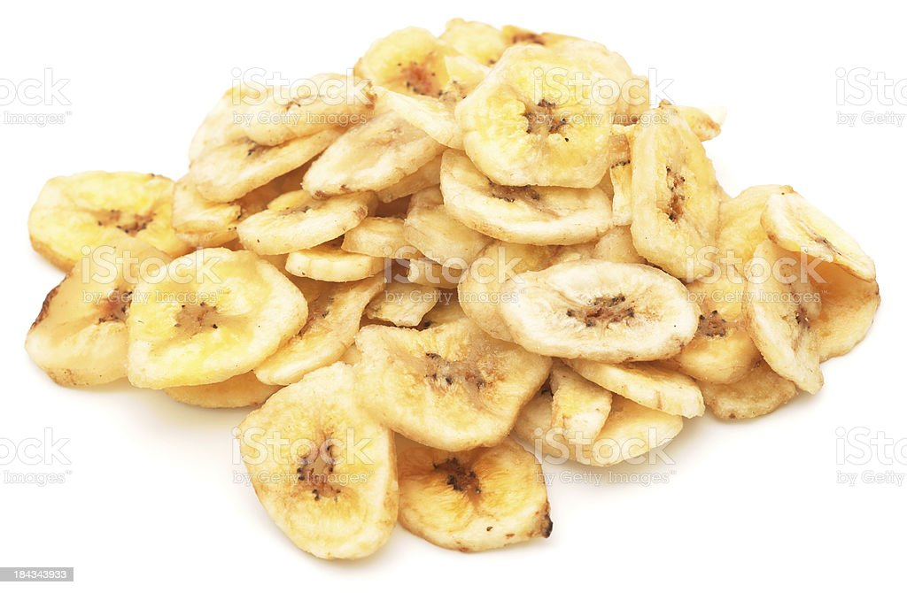 Dried banana chips pile isolated on white stock photo