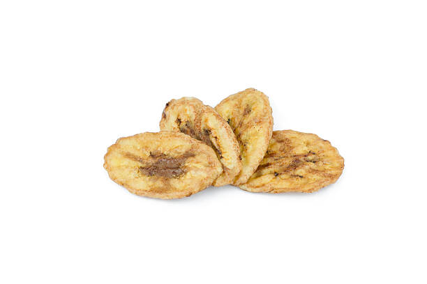 Dried banana slices isolated on white background stock photo