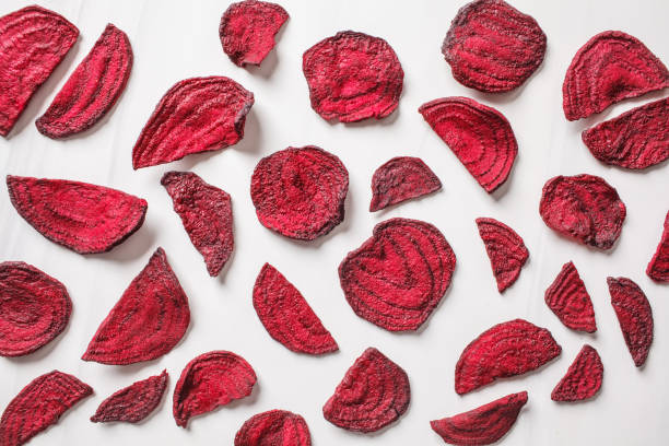 Dried beet chips on a white background, top view. stock photo