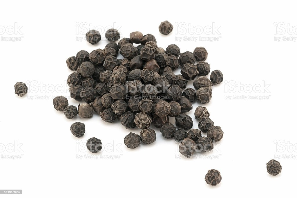 Dried black pepper - isolated on white stock photo