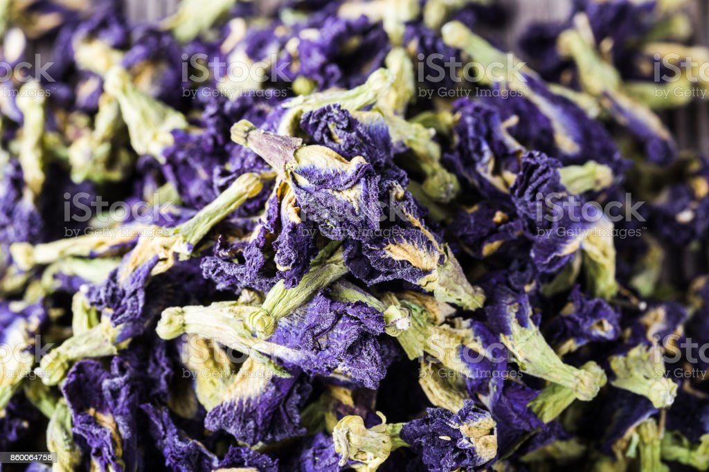 Dried blue butterfly pea flowers, healthy herbal tea stock photo