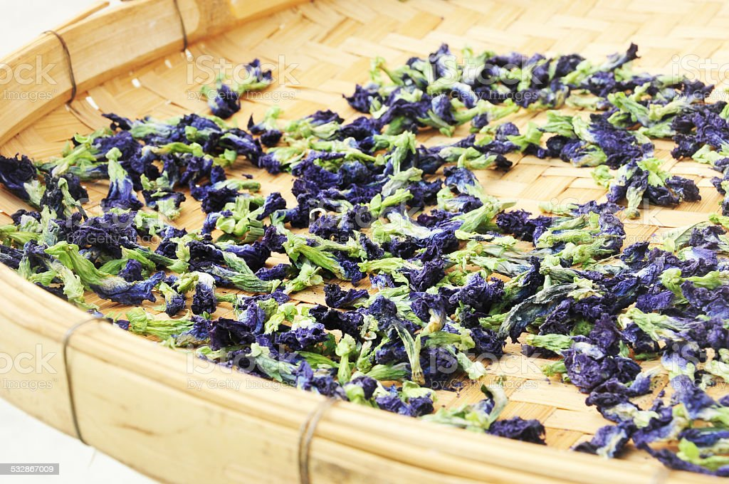 Dried butterfly pea herb flowers in bamboo basket stock photo