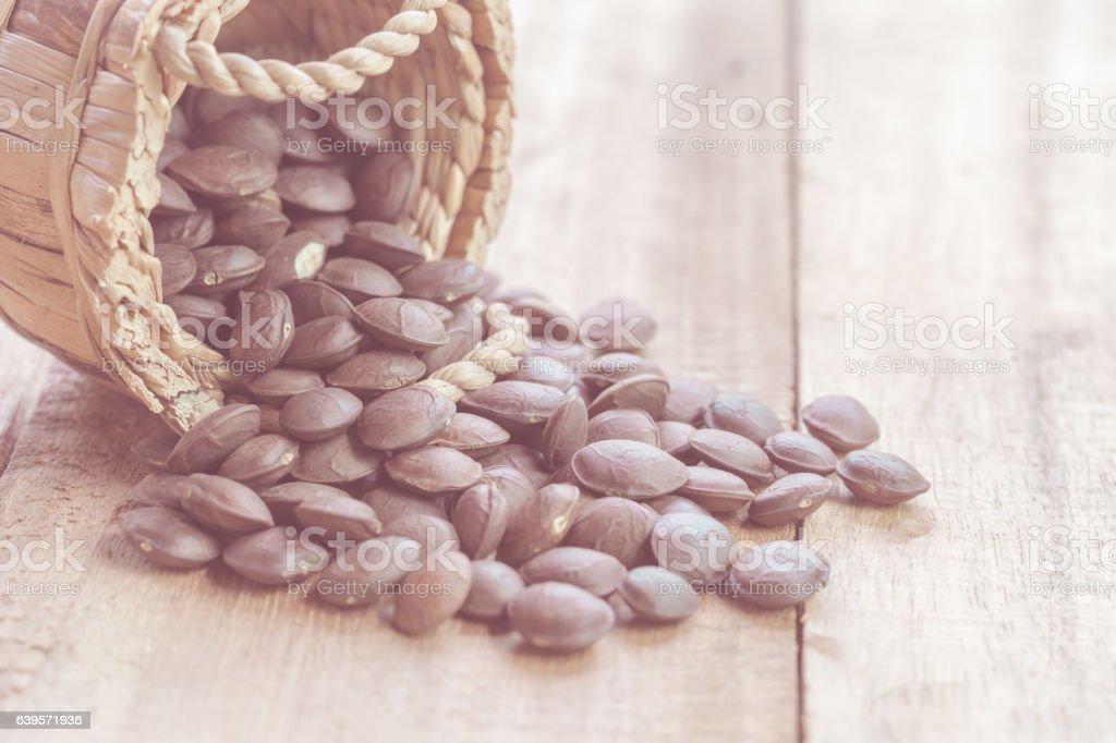 dried capsule seeds fruit of Sacha Inchi peanut on wooden stock photo