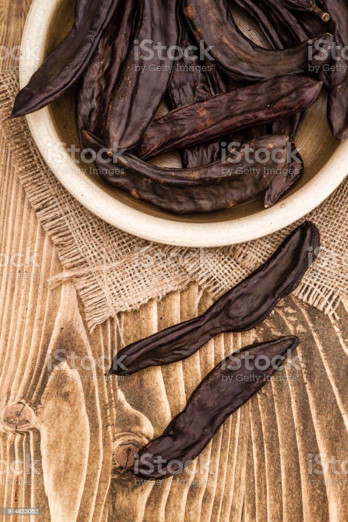 Vainas de algarroba secas, Ceratonia Siliqua - foto de stock