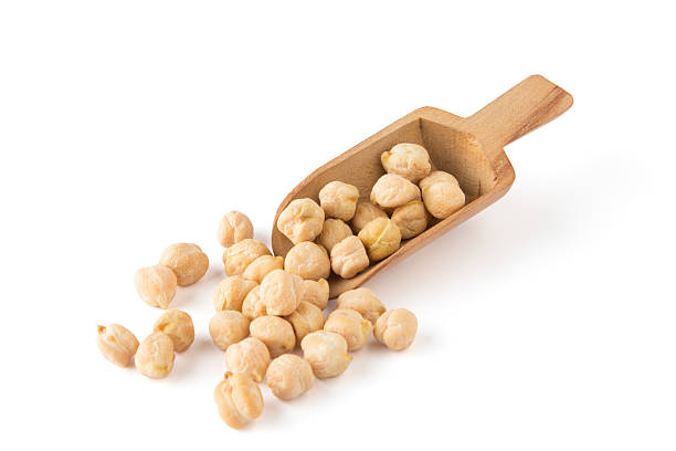 Dried chickpeas and a wooden scoop Chickpea With Scoop chick pea stock pictures, royalty-free photos & images