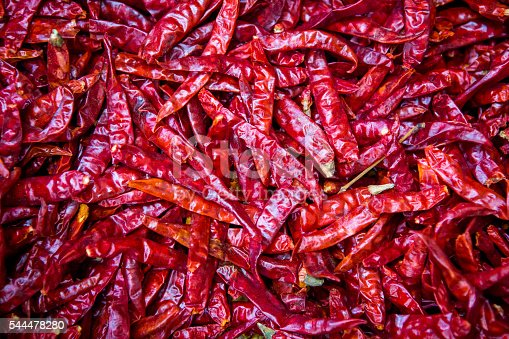 Dried red chile peppers on spice market in India. Close up.