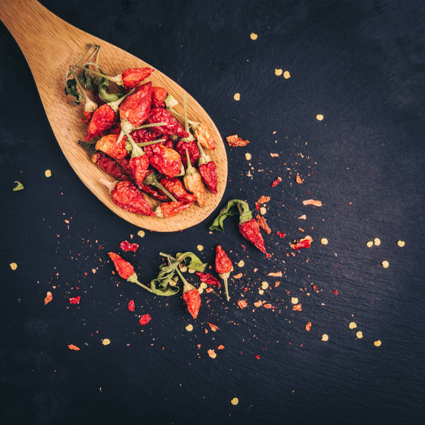 Dried Chili peppers mini on a black slate background stock photo