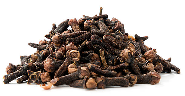 Dried Cloves Heap of dried cloves, syzygium aromaticum, isolated on white background. clove spice stock pictures, royalty-free photos & images
