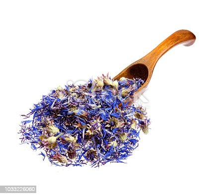 Dried cornflower tea on the wooden spoon.