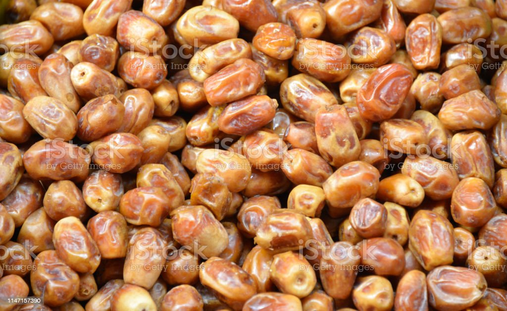 Dried date fruit on the market stand as a background