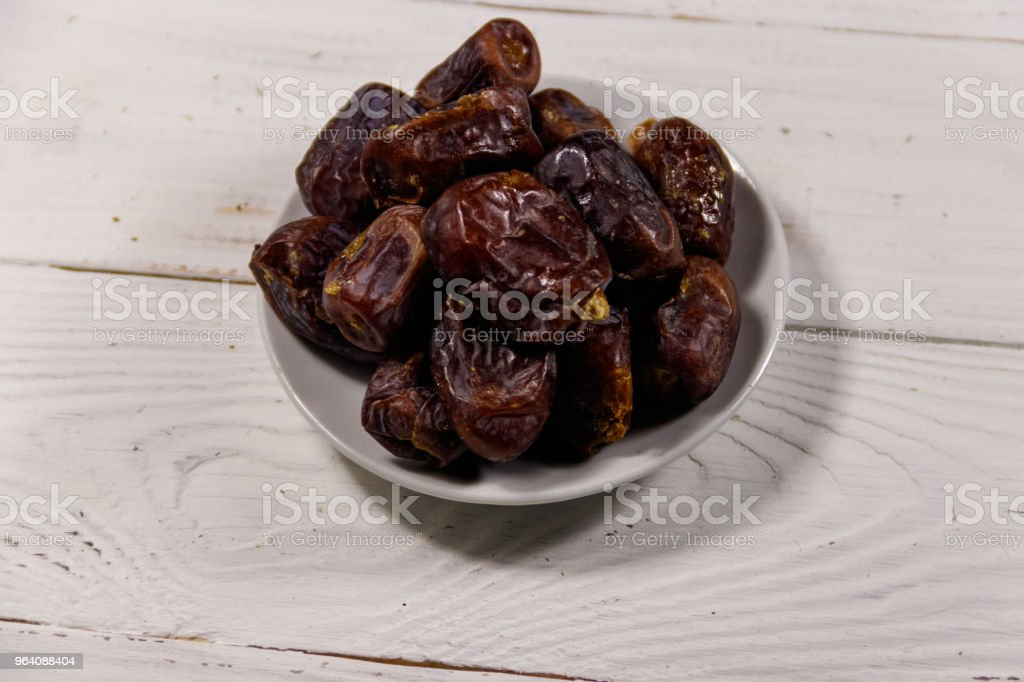 Dried dates fruit on white wooden table - Royalty-free Appetizer Stock Photo