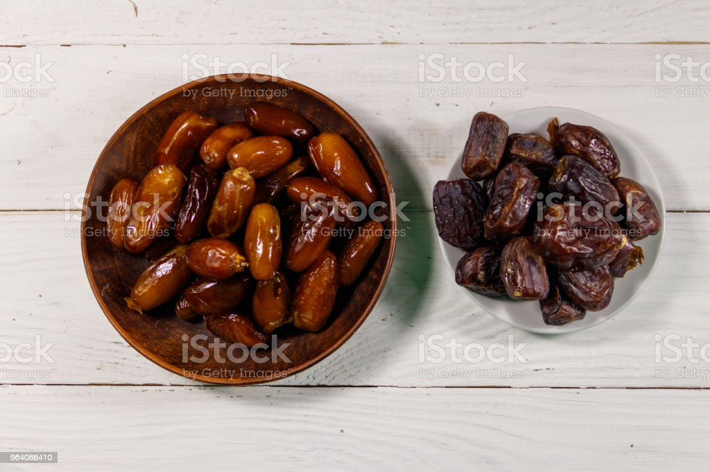 Dried dates fruit on white wooden table. Top view - Royalty-free Appetizer Stock Photo