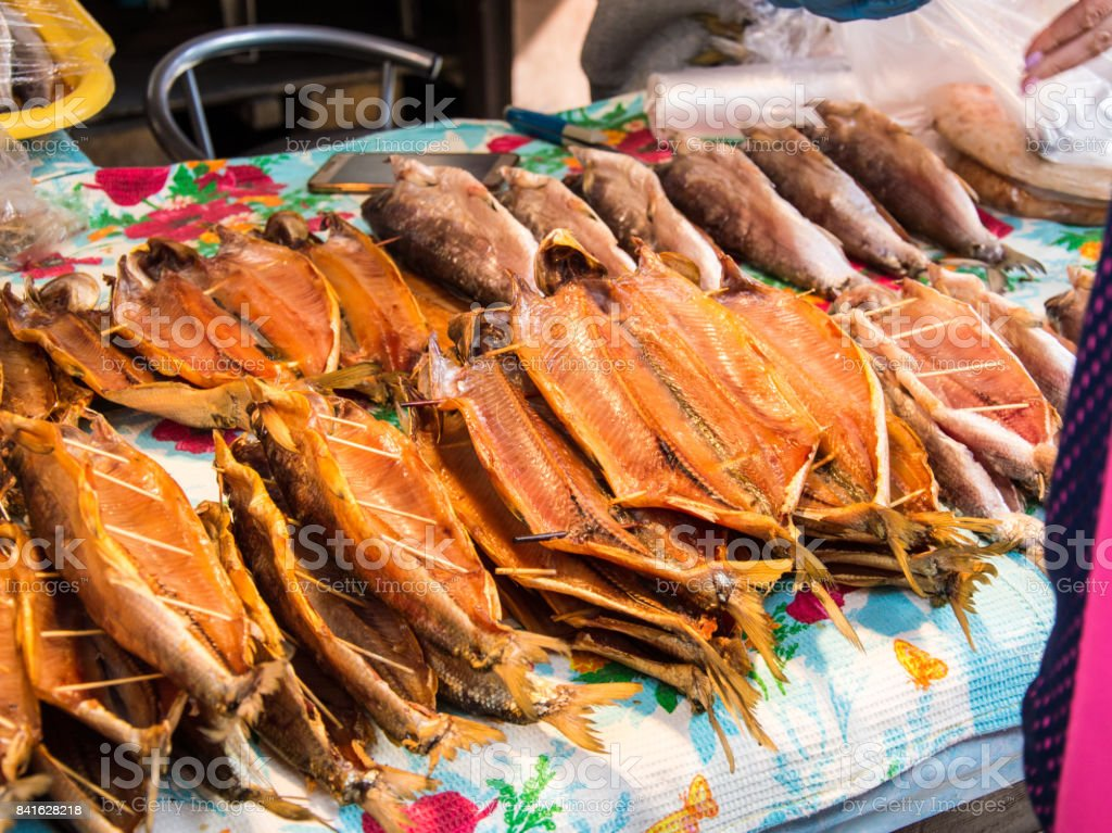 Dried fish Omul lying on the counter, fish market stock photo
