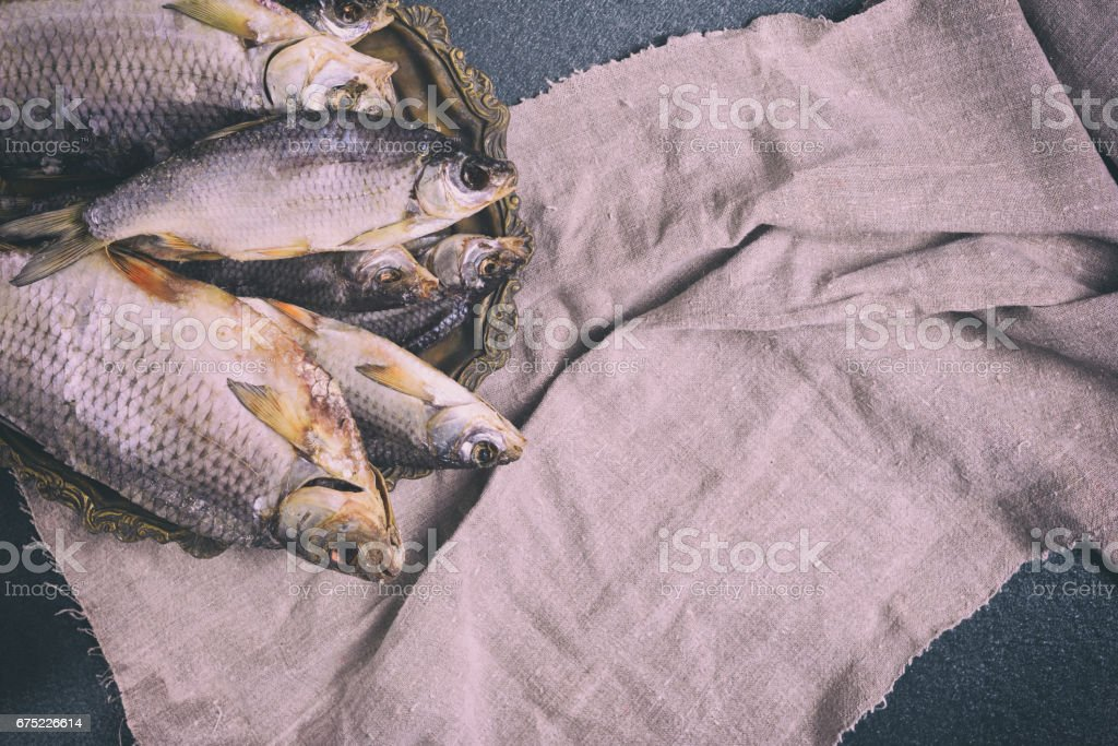 Dried fish on a copper plate, top view royalty-free stock photo