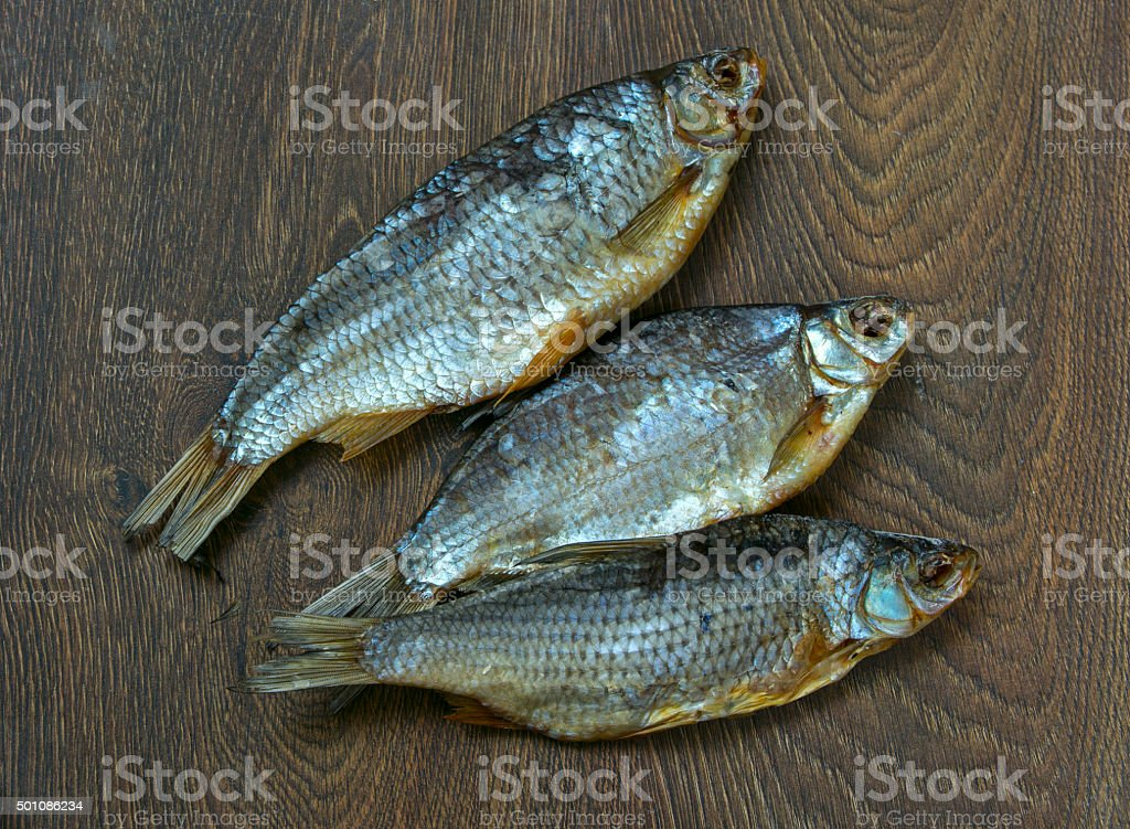 dried fish on wooden background. stock photo